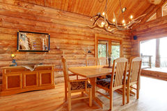 Log cabin dining room interior. Log cabin dining room interior with custom furniture Royalty Free Stock Photo