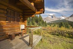 Cyclone Ranger Cabin and Snowcapped Canadian Rocky Mountain Tops stock images
