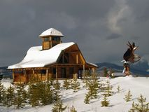 Log Cabin and Eagle Sculpture Stock Photography