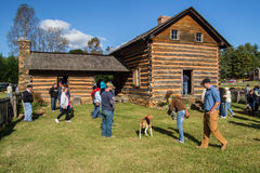 Log Cabin Exhibit and People Stock Photo