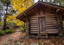 Log cabin in a forest in the fall. royalty free stock photos