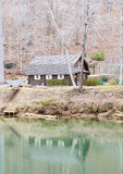 Log Cabin on Green River Royalty Free Stock Images