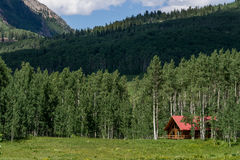 Log cabin home in mountain forest Royalty Free Stock Image