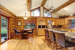 Log cabin house interior of dining and kitchen room Stock Photo