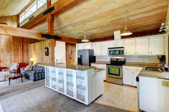 Log cabin house interior. Kitchen room Stock Photos