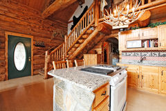 Log cabin house interior. View of entrance hall form kitchen roo Royalty Free Stock Image
