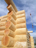 Log Cabin Joint. Corner joint on a log cabin under construction, with crane cable visible Royalty Free Stock Photos