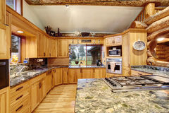Log cabin kitchen interior design with large storage combination Royalty Free Stock Photography