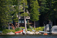 Log cabin by lake. Log cabin among trees by side of Wrights Lake, California, U.S.A Royalty Free Stock Images