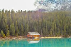 Log cabin on Lake Louise. In Banff National Park, Alberta, Canada with emerald waters Royalty Free Stock Image