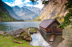 Lonely house on lake Obersee lake, Germany. Landscape with lonely house log cabin at bavarian lake Obersee, Berchtesgaden, Germany Royalty Free Stock Photo