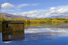 Log cabin and lake Stock Photo