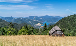 Log cabin on landscape Royalty Free Stock Photography
