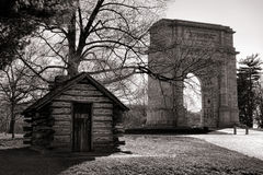 Log Cabin and Memorial Arch at Valley Forge Park Royalty Free Stock Photography