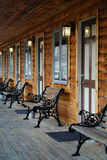 Log Cabin Motel. Exterior patio of a log cabin motel Stock Images