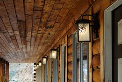 Log Cabin Motel Light. Outdoor lighting fixtures at a log cabin motel Stock Image