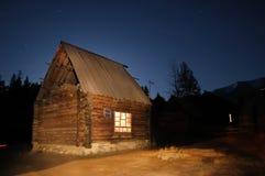Log Cabin at Night. A log cabin at night in Baihaba, the most north-western village of China, bordering Kazakhstan Stock Photo