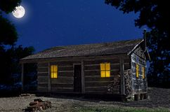 Log Cabin At Night Royalty Free Stock Photos
