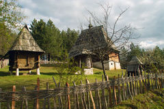 Log cabin. Old chalets placed on Mount Zlatibor done in the traditional style, Exceptionally well-preserved and still in use. The huts were built on a rock with Royalty Free Stock Photo
