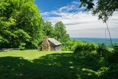 A log cabin overlooking the valley stock image