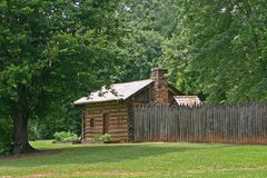 Log Cabin & Palisade Stock Images