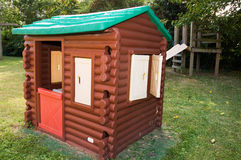 Log cabin playhouse. A view of a log cabin playhouse on an outdoor playground Royalty Free Stock Image