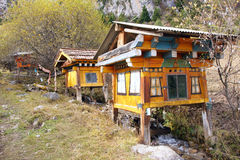 Log cabin of prayer wheel. The log cabin contains a prayer wheel Diebu, Gansu, China. The prayer wheel is driven by stream Royalty Free Stock Photography