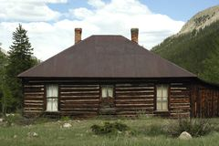 Log Cabin in the Rocky Mountains Stock Photo