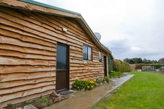 Log cabin in rural area, wide angle view Stock Image