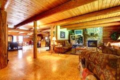 Log cabin rustic living room interior. Royalty Free Stock Image