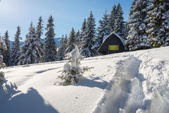 Log cabin, shelter in the winter mountains Stock Photo