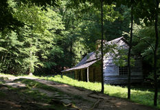 Log Cabin in Smoky Mountains. Primitive wooden building in rustic forest setting stock photography