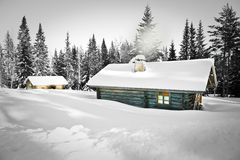 Log cabin in snow. Remote log cabin in untouched snow Stock Images