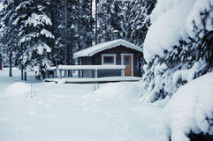 Log cabin in snow. Small cottage covered in snow Royalty Free Stock Photo
