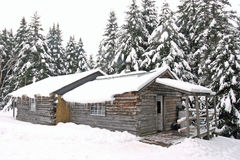 Log cabin in snow Royalty Free Stock Photo