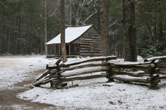 Log Cabin in the snow Stock Photo