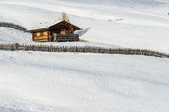 Log cabin in the snow stock images