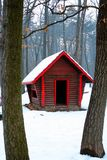 Log cabin in snow woods. Small log cabin in the woods with snow royalty free stock photo