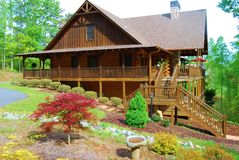 Log Cabin In the Spring Stock Photo