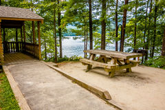 Log cabin surrounded by the forest at lake santeetlah north caro Stock Photo