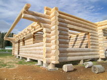 Log Cabin Under Construction. Log Cabin prior to disassembly and shipment, possibly overseas stock photo