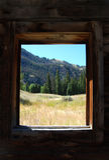 Log Cabin View. Mountain view through old log cabin window Stock Photos
