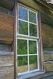 Log cabin window. Old log cabin with closeup of window Royalty Free Stock Photos