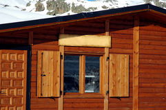 Log Cabin Window - Snowy Mountains Background Royalty Free Stock Images