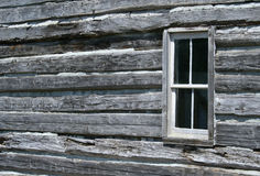 Log Cabin Window. The window in an old log cabin Stock Photos