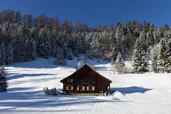 Log cabin in winter Royalty Free Stock Images