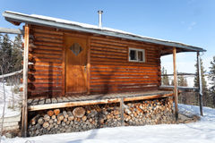 Log Cabin in winter Stock Image