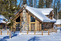 Log cabin in the winter forest of Idaho Royalty Free Stock Images