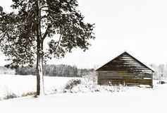 Log Cabin in a Winter Wonderland. A log cabin in a snowy, winter wonderland in Walworth County, Wisconsin Royalty Free Stock Images