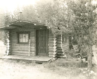 Log cabin in the woods Stock Photography